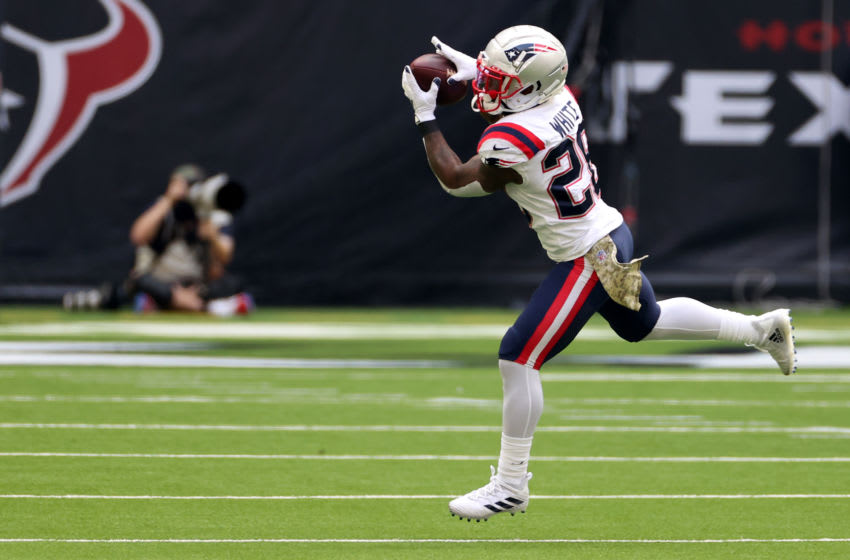 HOUSTON, TEXAS - NOVEMBER 22: James White #28 of the New England Patriots makes a second quarter catch during their game against the Houston Texans at NRG Stadium on November 22, 2020 in Houston, Texas. (Photo by Carmen Mandato/Getty Images)