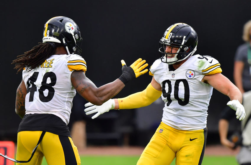 JACKSONVILLE, FLORIDA - NOVEMBER 22: T.J. Watt #90 and Bud Dupree #48 of the Pittsburgh Steelers react during the second half against the Jacksonville Jaguars at TIAA Bank Field on November 22, 2020 in Jacksonville, Florida. (Photo by Julio Aguilar/Getty Images)