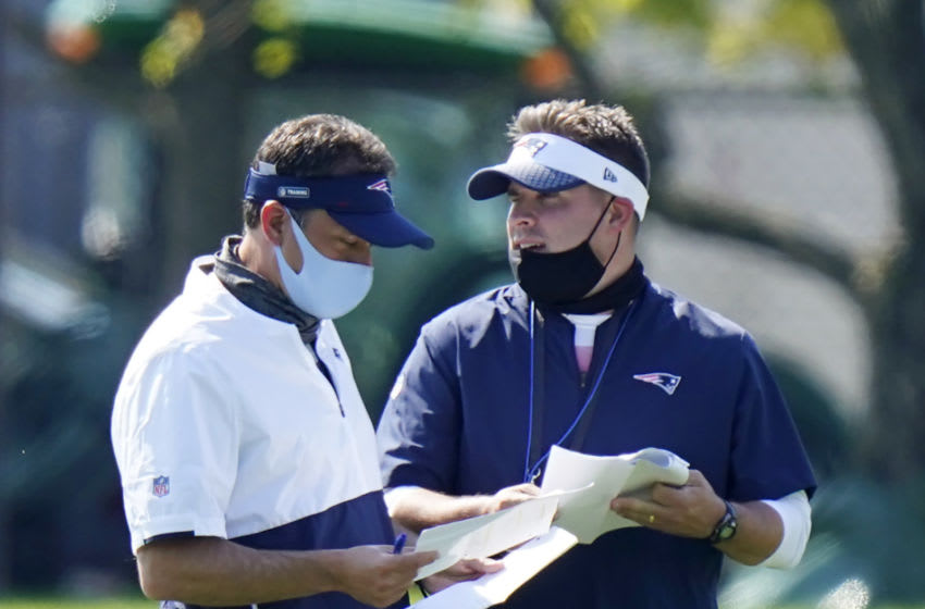 FOXBOROUGH, MASSACHUSETTS - AUGUST 23: New England Patriots quarterbacks coach Jedd Fisch, left, and offensive coordinator Josh McDaniels, right speak during training camp at Gillette Stadium on August 23, 2020 in Foxborough, Massachusetts. (Photo by Steven Senne-Pool/Getty Images)