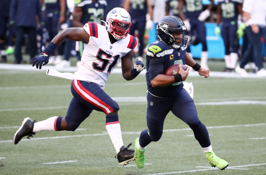 SEATTLE, WASHINGTON - SEPTEMBER 20: Russell Wilson #3 of the Seattle Seahawks runs with the ball as he is chased by Ja'Whaun Bentley #51 of the New England Patriots during the first quarter at CenturyLink Field on September 20, 2020 in Seattle, Washington. (Photo by Abbie Parr/Getty Images)