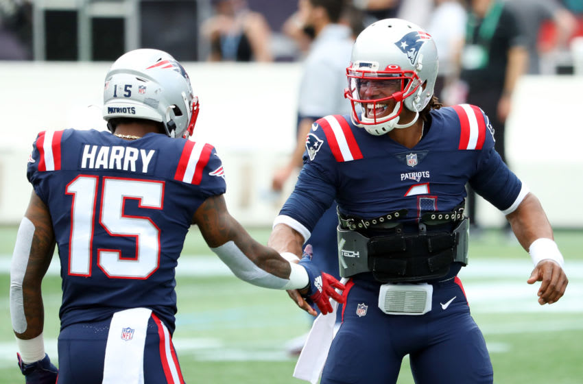 FOXBOROUGH, MASSACHUSETTS - SEPTEMBER 27: Cam Newton #1 of the New England Patriots reacts with N'Keal Harry #15 before the game against the Las Vegas Raiders at Gillette Stadium on September 27, 2020 in Foxborough, Massachusetts. (Photo by Maddie Meyer/Getty Images)