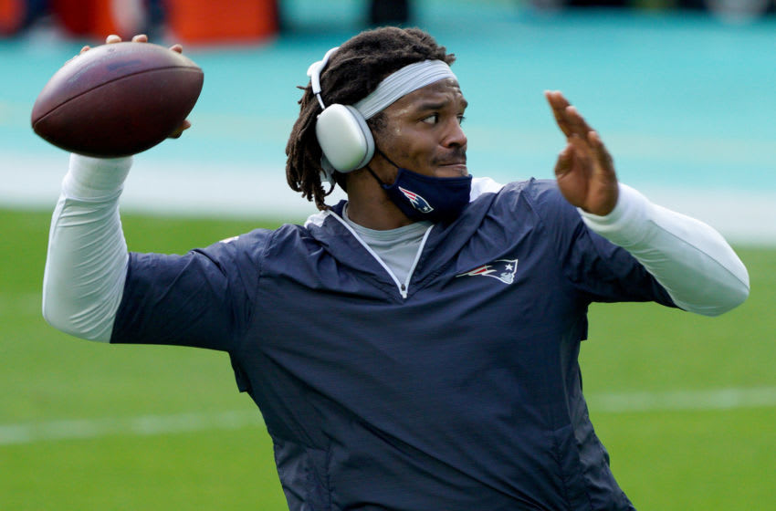 MIAMI GARDENS, FLORIDA - DECEMBER 20: Cam Newton #1 of the New England Patriots warms up prior to the game against the Miami Dolphins at Hard Rock Stadium on December 20, 2020 in Miami Gardens, Florida. (Photo by Mark Brown/Getty Images)