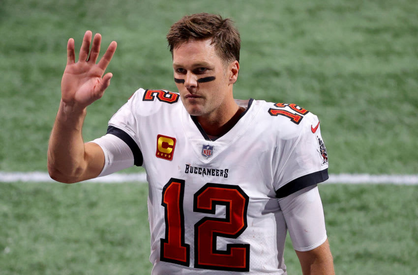 ATLANTA, GEORGIA - DECEMBER 20: Tom Brady #12 of the Tampa Bay Buccaneers waves after defeating the Atlanta Falcons in the game at Mercedes-Benz Stadium on December 20, 2020 in Atlanta, Georgia. (Photo by Kevin C. Cox/Getty Images)