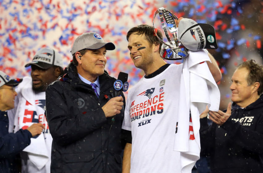 FOXBORO, MA - JANUARY 18: Tom Brady #12 of the New England Patriots holds up the Lamar Hunt Trophy after defeating the Indianapolis Colts in the 2015 AFC Championship Game at Gillette Stadium on January 18, 2015 in Foxboro, Massachusetts. The Patriots defeated the Colts 45-7. (Photo by Jim Rogash/Getty Images)