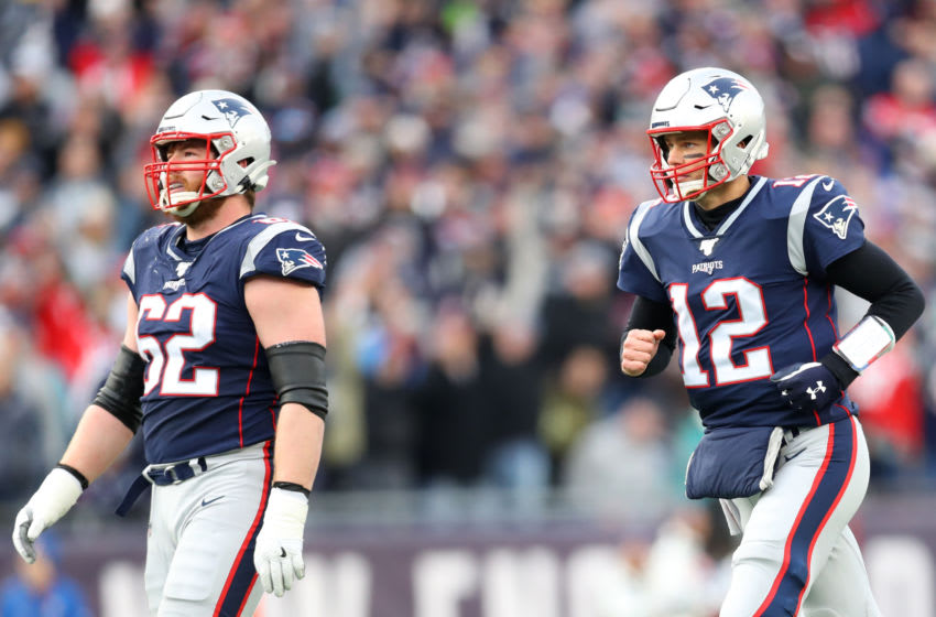 FOXBOROUGH, MASSACHUSETTS - DECEMBER 29: Tom Brady #12 of the New England Patriots and Joe Thuney #62 during the game against the Miami Dolphins at Gillette Stadium on December 29, 2019 in Foxborough, Massachusetts. (Photo by Maddie Meyer/Getty Images)