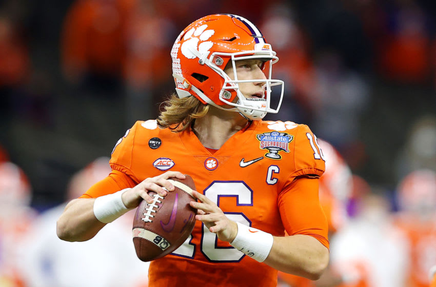 NEW ORLEANS, LOUISIANA - JANUARY 01: Trevor Lawrence #16 of the Clemson Tigers looks to pass against the Ohio State Buckeyes in the first quarter during the College Football Playoff semifinal game at the Allstate Sugar Bowl at Mercedes-Benz Superdome on January 01, 2021 in New Orleans, Louisiana. (Photo by Kevin C. Cox/Getty Images)