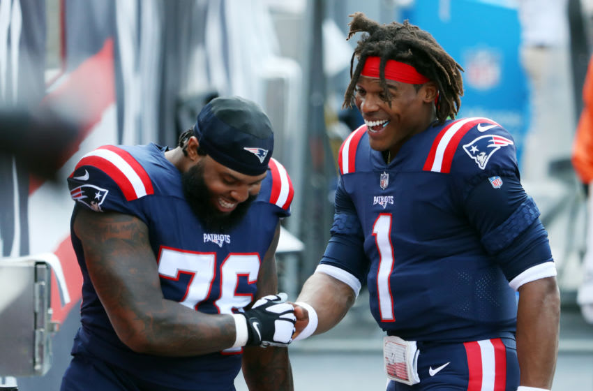 FOXBOROUGH, MASSACHUSETTS - SEPTEMBER 13: Cam Newton #1 of the New England Patriots reacts with Isaiah Wynn #76 (Photo by Maddie Meyer/Getty Images)