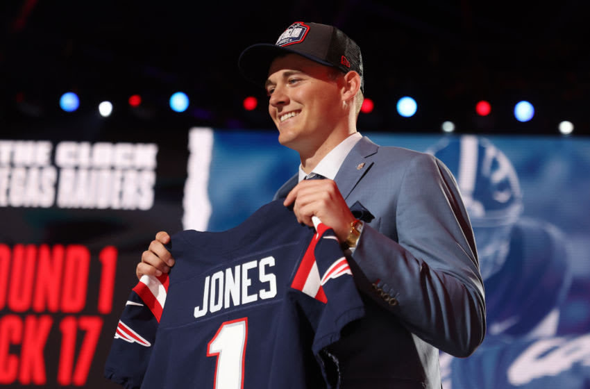 CLEVELAND, OHIO - APRIL 29: Mac Jones poses onstage after being selected 15th by the New England Patriots (Photo by Gregory Shamus/Getty Images)