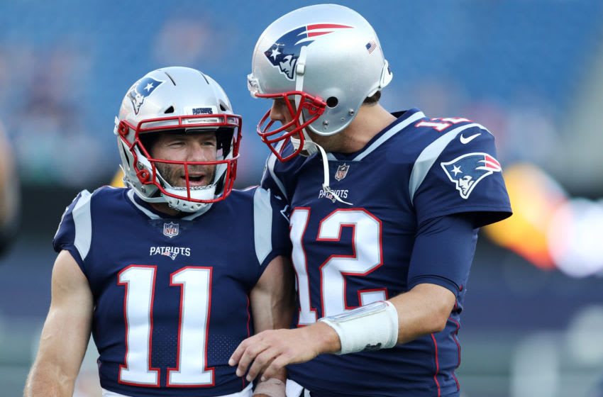 FOXBOROUGH, MA - AUGUST 9 : Tom Brady #12 of the New England Patriots talks with Julian Edelman #11 before the preseason game between the New England Patriots and the Washington Redskins at Gillette Stadium on August 9, 2018 in Foxborough, Massachusetts. (Photo by Maddie Meyer/Getty Images)