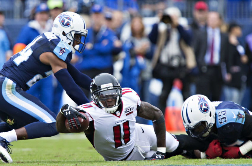 NASHVILLE, TN - OCTOBER 25: Julio Jones #11 of the Atlanta Falcons reaches the ball out to try and get a first down after being tackled by Zach Brown #55 of the Tennessee Titans at Nissan Stadium on October 25, 2015 in Nashville, Tennessee. The Falcons defeated the Titans 10-7. (Photo by Wesley Hitt/Getty Images)