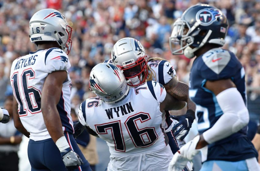 New England Patriots running back Brandon Bolden (38) celebrates his touchdown with New England Patriots offensive tackle Isaiah Wynn (76) in the second quarter of a preseason game against the Titans at Nissan Stadium Saturday, Aug. 17, 2019 in Nashville, Tenn. An18025