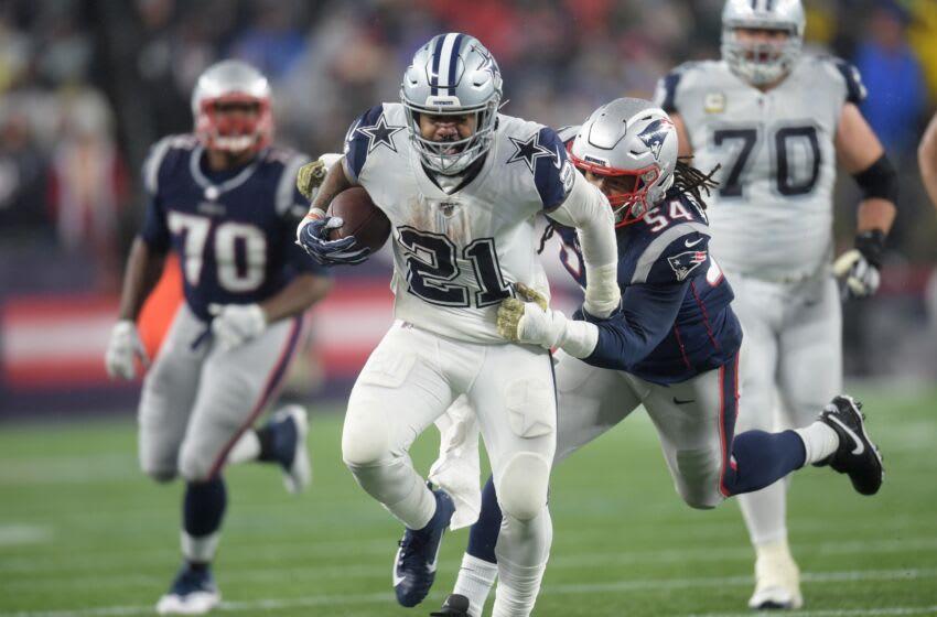 Nov 24, 2019; Foxborough, MA, USA; Dallas Cowboys running back Ezekiel Elliott (21) breaks the tackle of New England Patriots outside linebacker Dont'a Hightower (54) during the second half at Gillette Stadium. Mandatory Credit: Bob DeChiara-USA TODAY Sports
