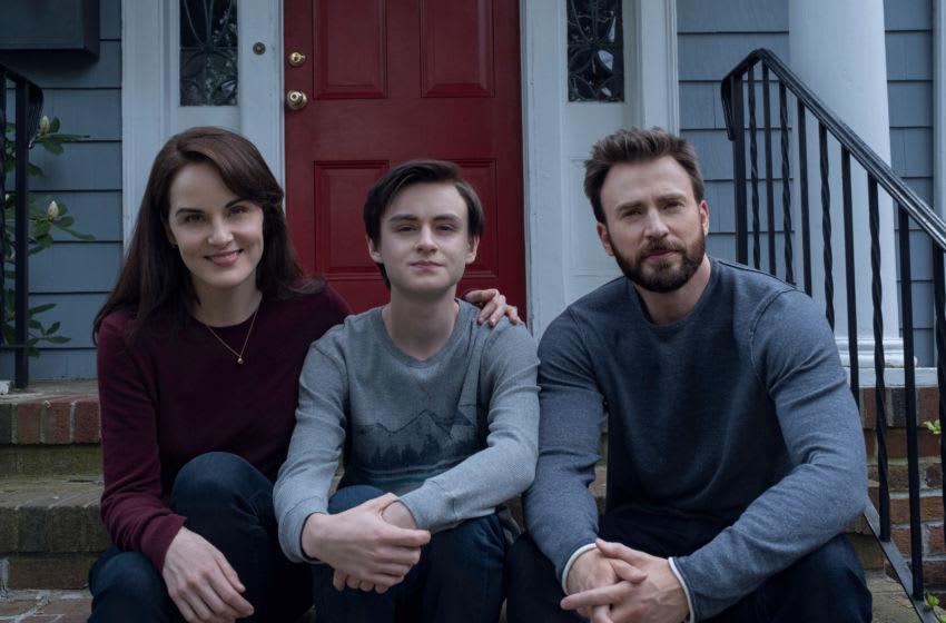 "Michelle Dockery, Jaeden Martell and Chris Evans in ""Defending Jacob,"" premiering April 24 on Apple TV - Credit: Apple TV+"
