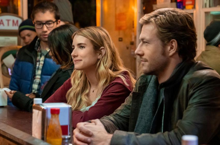 HOLIDATE (2020) Emma Roberts as Sloane Reed and Luke Bracey as Jackson. Cr. Steve Dietl/NETFLIX