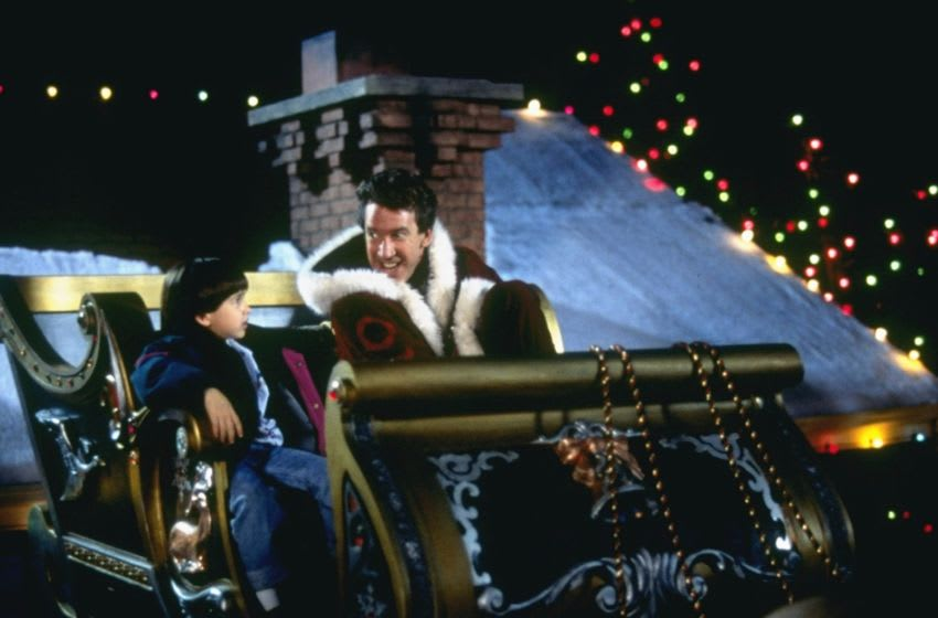 THE SANTA CLAUSE - Tim Allen provides answers -- warm and funny answers -- to some of the world's most vexing questions: How can Santa come down your chimney if you don't have a fireplace? How does he get to every house in the world in just one night? And how do you get a job like that, anyway? (DISNEY/ATTILA DORY) ERIC LLOYD, TIM ALLEN