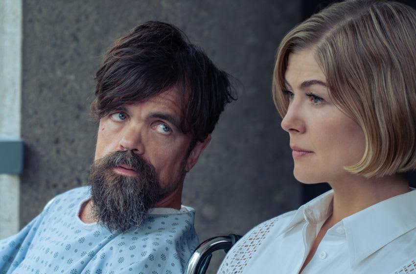 I CARE A LOT (2021) Peter Dinklage as Rukov and Rosamund Pike as Marla. Cr: Seacia Pavao/NETFLIX