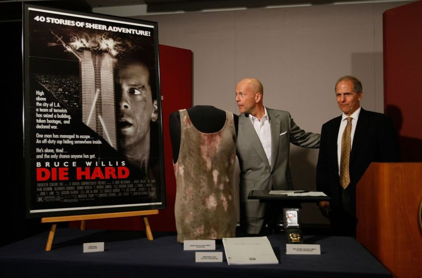 WASHINGTON - JUNE 27: Actor Bruce Willis (L) and Director of the National Museum of American History Brent Glass (R) pose with objects from the