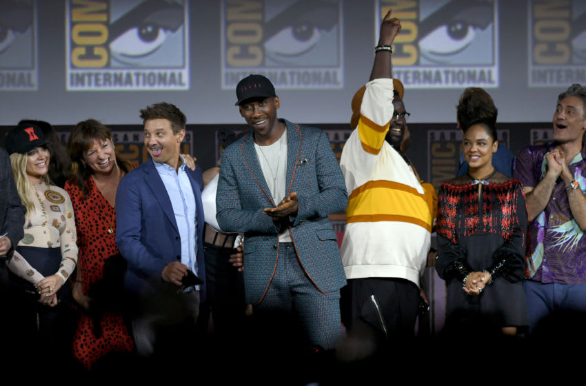 SAN DIEGO, CALIFORNIA - JULY 20: (L-R) Florence Pugh, Cate Shortland, Jeremy Renner, Mahershala Ali, Brian Tyree Henry, Tessa Thompson and Taika Waititi speak at the Marvel Studios Panel during 2019 Comic-Con International at San Diego Convention Center on July 20, 2019 in San Diego, California. (Photo by Kevin Winter/Getty Images)