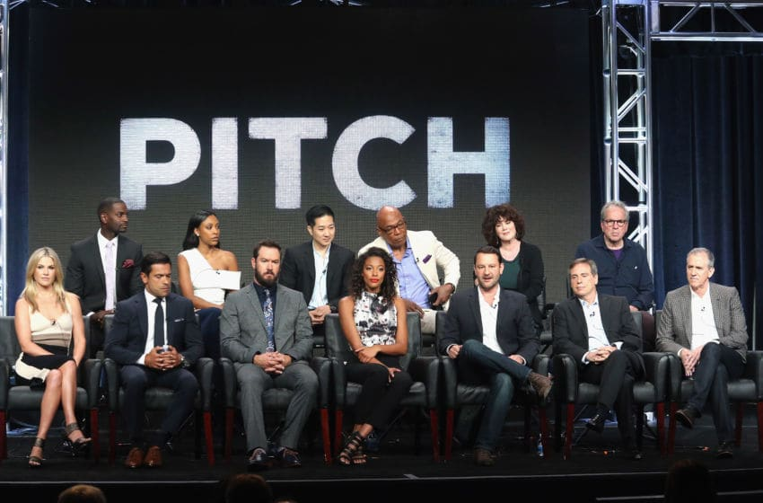 BEVERLY HILLS, CA - AUGUST 08: (L-R Back Row) Actors Mo McRae, Meagan Holder, Tim Jo, executive producer/director Paris Barclay, executive producer Helen Bartlett, executive producer Tony Bill, (L-R Front Row) actors Ali Larter, Mark Consuelos, Mark-Paul Gosselaar, Kylie Bunbury, creator/executive producer Dan Fogelman, creator/executive producer Rick Singer and executive producer Kevin Falls speak onstage at the 'Pitch' panel discussion during the FOX portion of the 2016 Television Critics Association Summer Tour at The Beverly Hilton Hotel on August 8, 2016 in Beverly Hills, California. (Photo by Frederick M. Brown/Getty Images)
