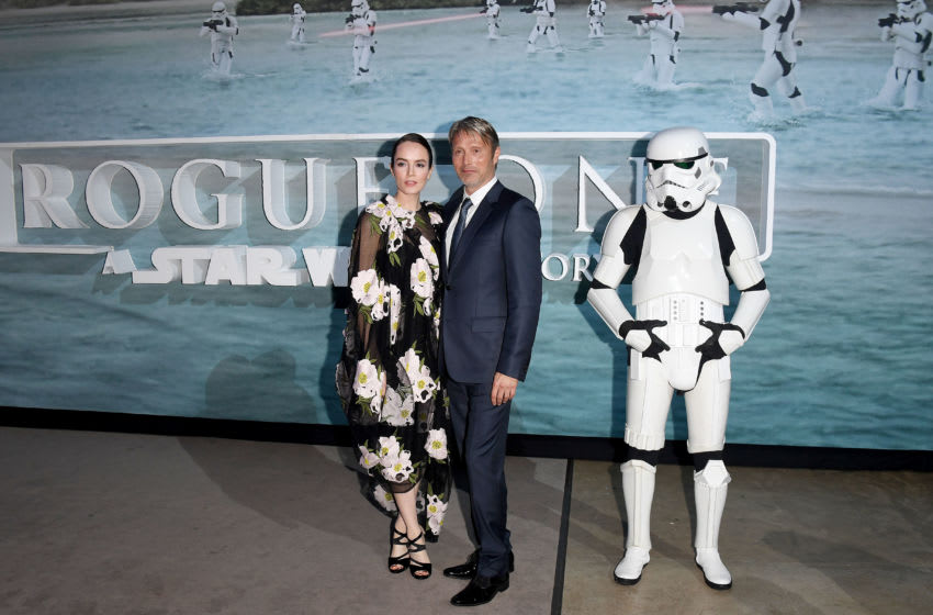 LONDON, ENGLAND - DECEMBER 13: Valene Kane and Mads Mikkelsen at the launch event and reception for Lucasfilm's highly anticipated, first-ever, standalone Star Wars adventure 'Rogue One: A Star Wars Story' at the Tate Modern on December 13, 2016 in London, England. (Photo by Stuart C. Wilson/Getty Images for Disney)