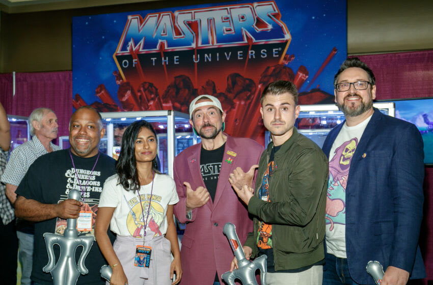 ANAHEIM, CALIFORNIA - AUGUST 18: Writer and director Kevin Smith (C) joined DC writers and illustrators to announce the new DC comic book limited series, He-Man and the Masters is the Multiverse. The 6-book series will be available at retailers starting November 2019. (Photo by Rich Polk/Getty Images for Mattel)