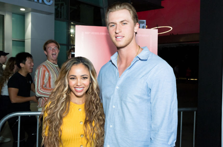 HOLLYWOOD, CALIFORNIA - SEPTEMBER 12: Vanessa Morgan and Michael Kopech attend the Premiere Of Neon And Refinery29's
