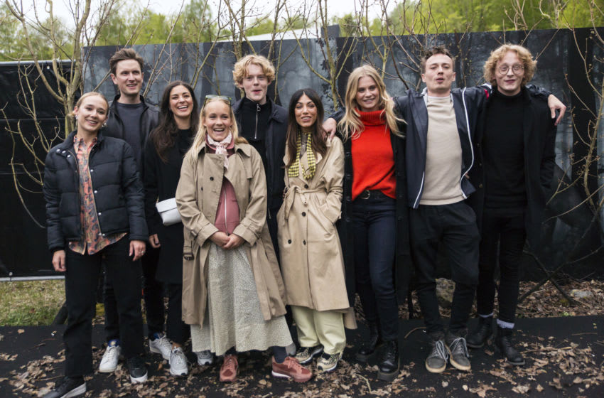 """LYNGE, DENMARK - MAY 08: Actors in """"The Rain"""" season 2 are posing together with guests at arrival after the bus ride to the """"secret"""" destination for the Netflix's"""