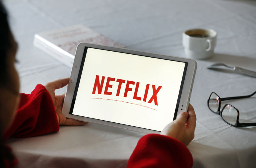 PARIS, FRANCE - NOVEMBER 20: PARIS, FRANCE - NOVEMBER 20: In this photo illustration, the Netflix media service provider's logo is displayed on the screen of a tablet on November 20, 2019 in Paris, France. Netflix, the US giant of online video subscription, has more than 5 million subscribers in France, 4 and a half years after its arrival in France in September 2014. Netflix offers movies and TV series over the internet and now has 137 million subscribers worldwide. (Photo by Chesnot/Getty Images)
