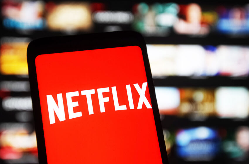 UKRAINE - 2021/01/20: In this photo illustration the Netflix logo seen displayed on a mobile phone and on a pc screen. (Photo Illustration by Pavlo Gonchar/SOPA Images/LightRocket via Getty Images)