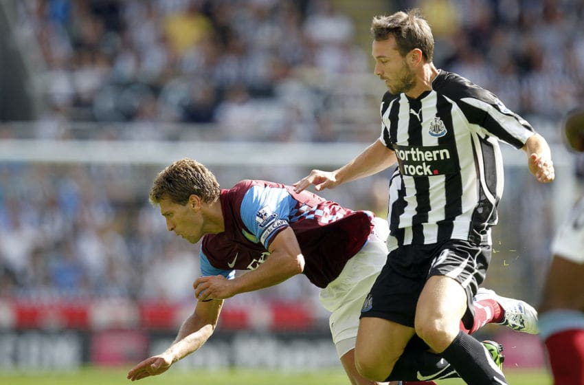 Newcastle United's Spanish striker, Xisco (R) vies with Aston Villa's Bulgarian midfielder, Stiliyan Petrov (L) during an English FA Premier League football match at St James' Park, Newcastle upon Tyne, England, on August 22, 2010. AFP PHOTO/GRAHAM STUART - FOR EDITORIAL USE ONLY Additional licence required for any commercial/promotional use or use on TV or internet (except identical online version of newspaper) of Premier League/Football League photos. Tel DataCo +44 207 2981656. Do not alter/modify photo. (Photo credit should read GRAHAM STUART/AFP via Getty Images)