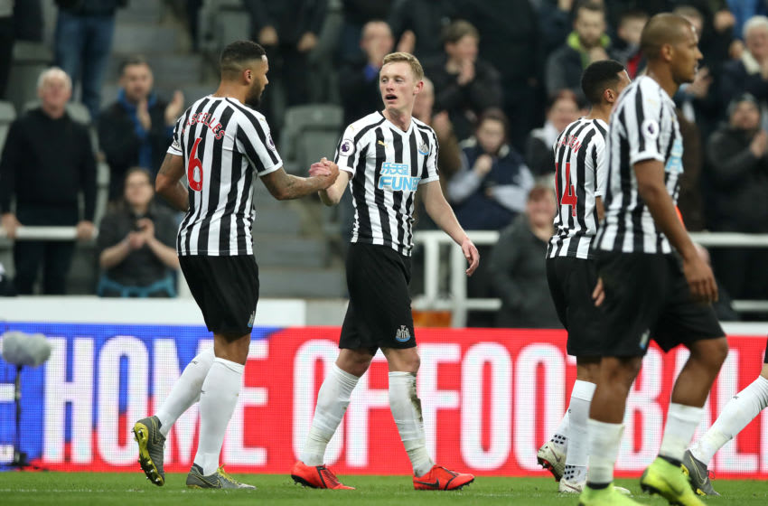 NEWCASTLE UPON TYNE, ENGLAND - FEBRUARY 26: Sean Longstaff of Newcastle United celebrates after scoring his team's second goal with team mate Jamaal Lascelles (L) during the Premier League match between Newcastle United and Burnley FC at St. James Park on February 26, 2019 in Newcastle upon Tyne, United Kingdom. (Photo by Ian MacNicol/Getty Images)