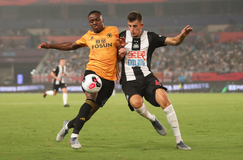 NANJING, CHINA - JULY 17: Kelland Watts (R) of Newcastle United in action with Niall Ennis of Wolverhampton Wanderers during the Premier League Asia Trophy 2019 match between Newcastle United and Wolverhampton Wanderers at Olympic Sports Center Stadium on July 17, 2019 in Nanjing, China. (Photo by Lintao Zhang/Getty Images for Premier League)