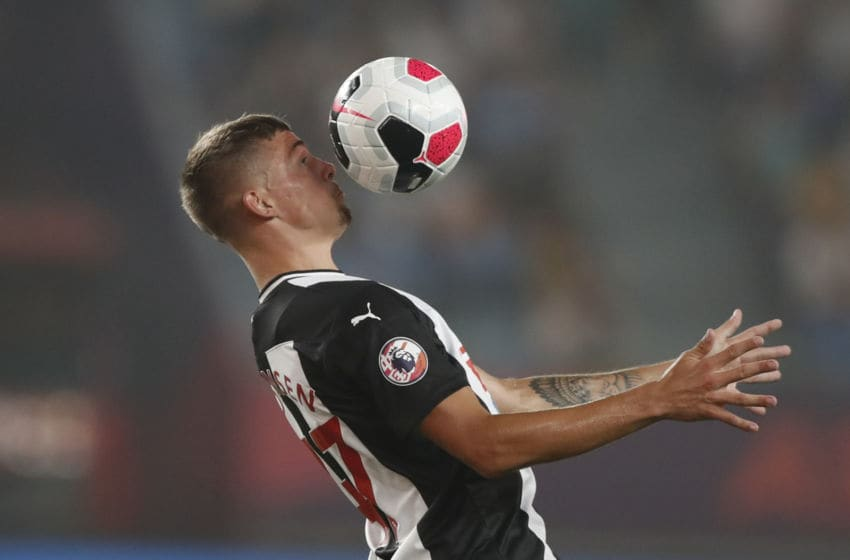 NANJING, CHINA - JULY 17: Elias Sorensen #47 of Newcastle United controls the ball during the Premier League Asia Trophy 2019 fixture between Newcastle United and Wolverhampton Wanderers at Nanjing Olympic Sports Centre on July 17, 2019 in Nanjing, China.(Photo by Fred Lee/Getty Images for Premier League)