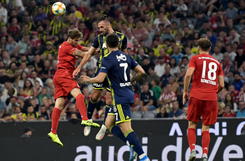 MUNICH, GERMANY - JULY 30: Javi Martinez of FC Bayern Muenchen (2nL) and Vedat Muriqi of Fenerbahce fight for the ball during the Audi cup 2019 semi final match between FC Bayern Muenchen and Fenerbahce at Allianz Arena on July 30, 2019 in Munich, Germany. (Photo by Alexander Scheuber/Getty Images for AUDI)