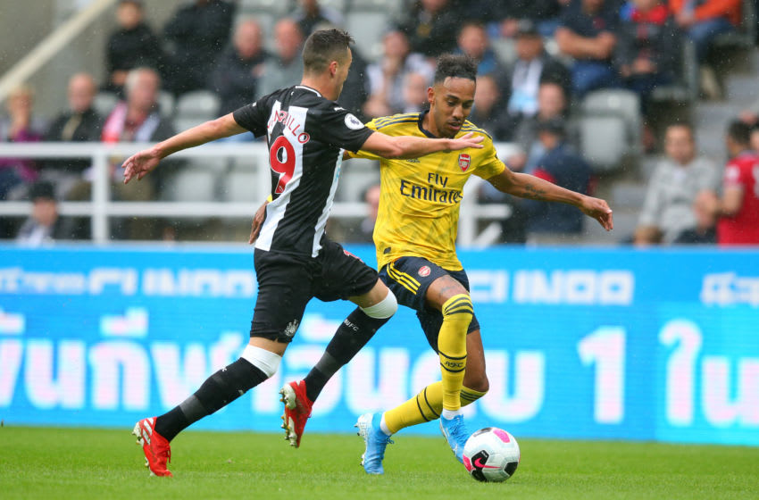 Pierre-Emerick Aubameyang of Arsenal battles with Javier Manquillo of Newcastle United. (Photo by Alex Livesey/Getty Images)