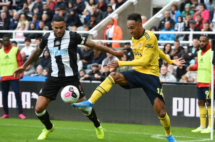NEWCASTLE UPON TYNE, ENGLAND - AUGUST 11: Pierre-Emerick Aubameyang of Arsenal is challenged by Jamaal Lascelles of Newcastle United during the Premier League match between Newcastle United and Arsenal FC at St. James Park on August 11, 2019 in Newcastle upon Tyne, United Kingdom. (Photo by Harriet Lander/Copa/Getty Images)