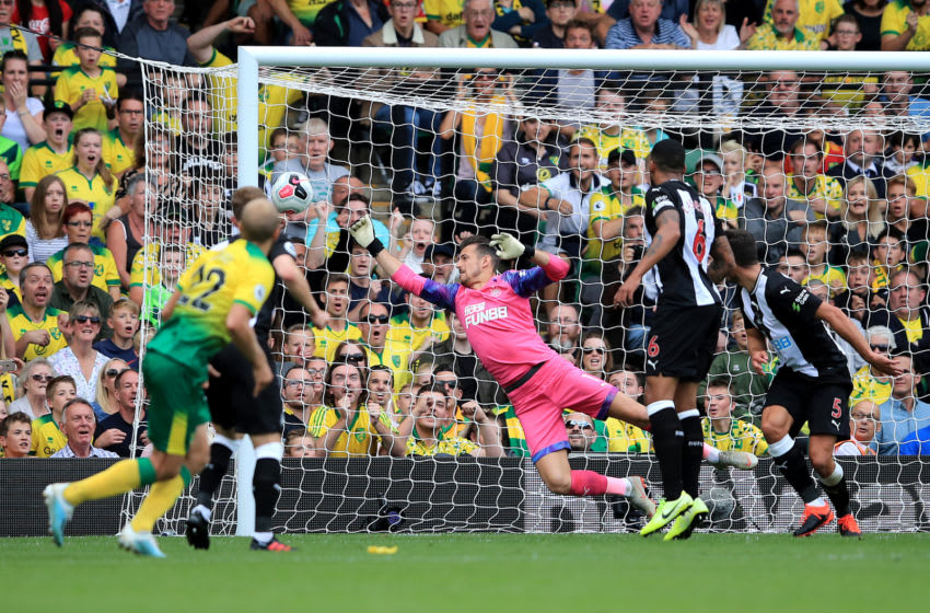 NORWICH, ENGLAND - AUGUST 17: Teemu Pukki of Norwich City scores his team's first goal past Martin Dubravka of Newcastle United during the Premier League match between Norwich City and Newcastle United at Carrow Road on August 17, 2019 in Norwich, United Kingdom. (Photo by Marc Atkins/Getty Images)