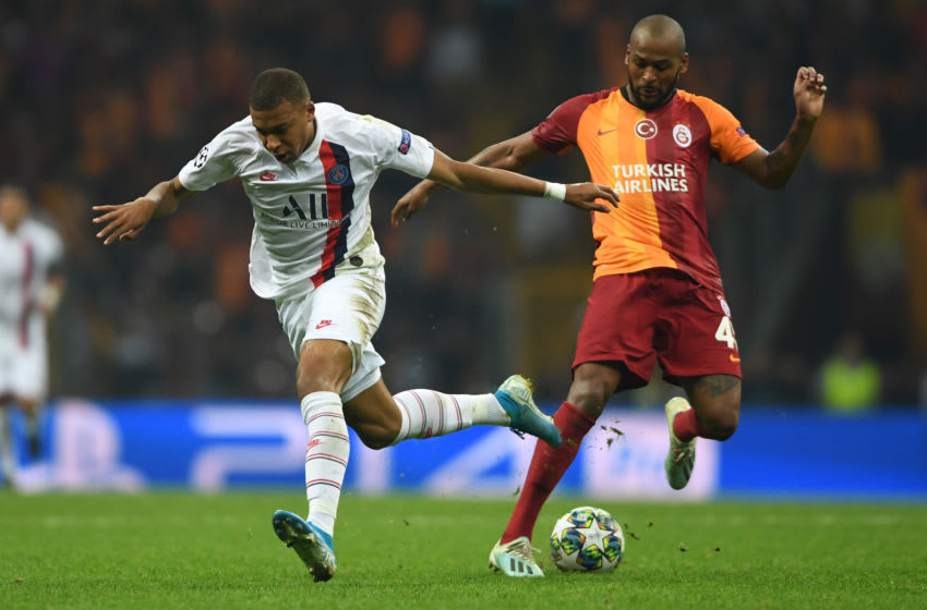 Kylian Mbappe (L) vies with Galatasaray's Brazilian defender Marcao Teixeira. (Photo by OZAN KOSE/AFP via Getty Images)