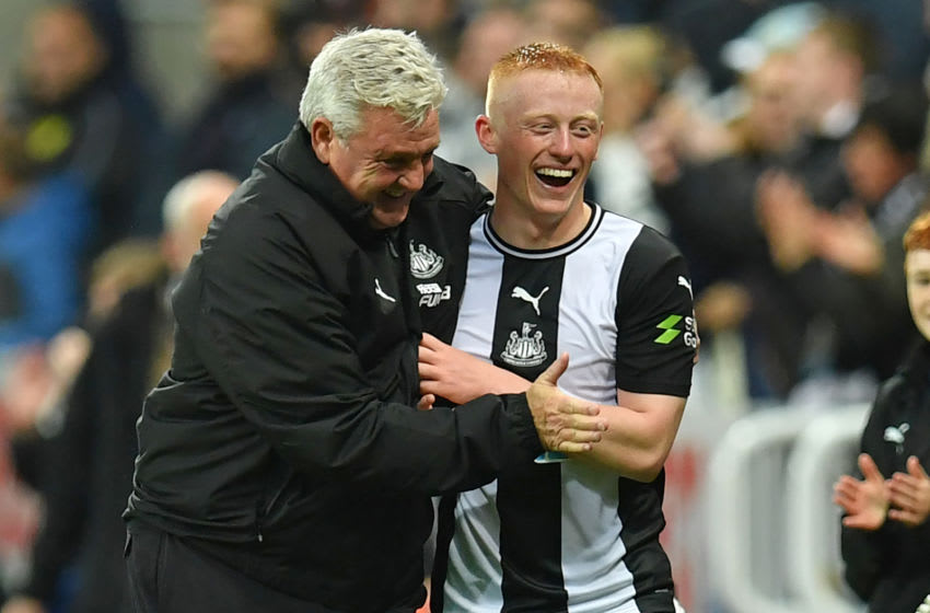Newcastle United's English head coach Steve Bruce (L) congratulates goalscorer Newcastle United's English midfielder Matthew Longstaff (R) after the English Premier League football match between Newcastle United and Manchester United at St James's Park in Newcastle-upon-Tyne, north east England on October 6, 2019. - Newcastle won the game 1-0. (Photo by Paul ELLIS / AFP) / RESTRICTED TO EDITORIAL USE. No use with unauthorized audio, video, data, fixture lists, club/league logos or 'live' services. Online in-match use limited to 120 images. An additional 40 images may be used in extra time. No video emulation. Social media in-match use limited to 120 images. An additional 40 images may be used in extra time. No use in betting publications, games or single club/league/player publications. / (Photo by PAUL ELLIS/AFP via Getty Images)