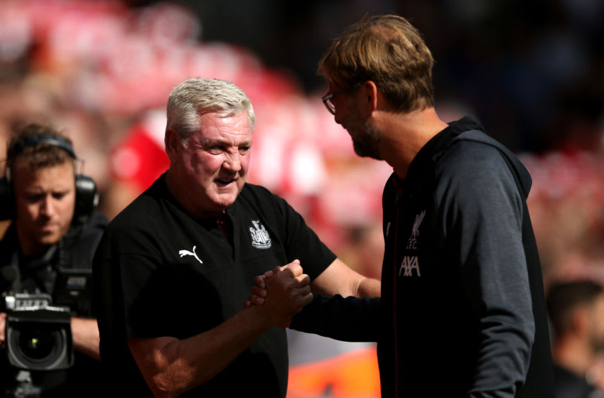 Jurgen Klopp, Manager of Liverpool greets Steve Bruce, Manager of Newcastle United. (Photo by Jan Kruger/Getty Images)