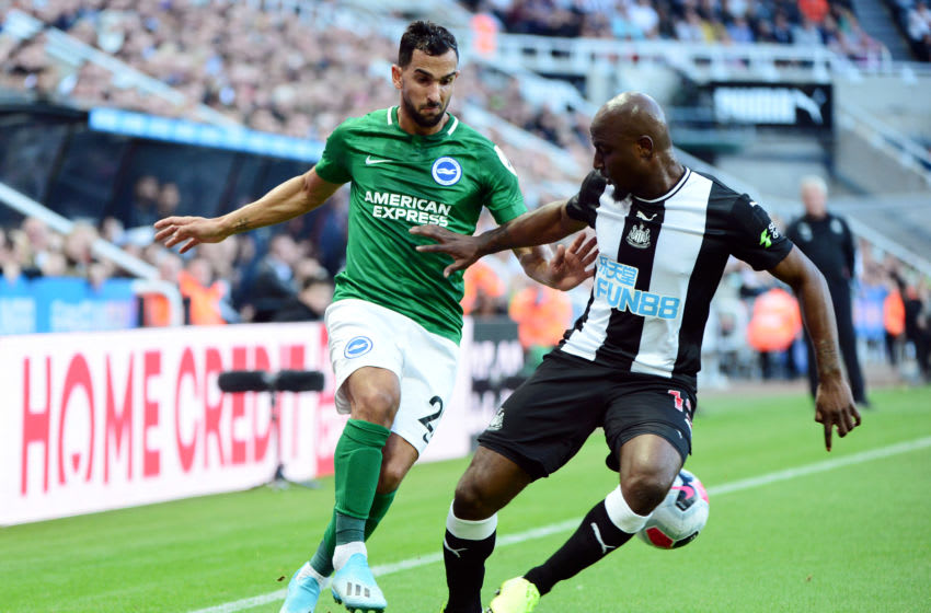 Martin Montoya of Brighton and Hove Albion is challenged by Jetro Willems of Newcastle United. (Photo by Mark Runnacles/Getty Images)