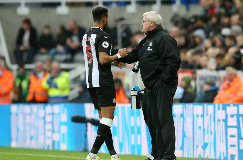 Joelinton of Newcastle United receives instructions from Steve Bruce, Manager of Newcastle United. (Photo by Jan Kruger/Getty Images)