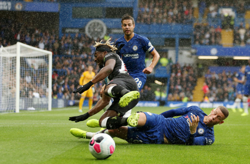LONDON, ENGLAND - OCTOBER 19: Ross Barkley of Chelsea tackles Allan Saint-Maximin of Newcastle United during the Premier League match between Chelsea FC and Newcastle United at Stamford Bridge on October 19, 2019 in London, United Kingdom. (Photo by Paul Harding/Getty Images)
