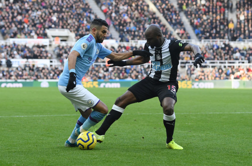 Riyad Mahrez of Manchester City is challenged by Jetro Willems of Newcastle United. (Photo by Stu Forster/Getty Images)