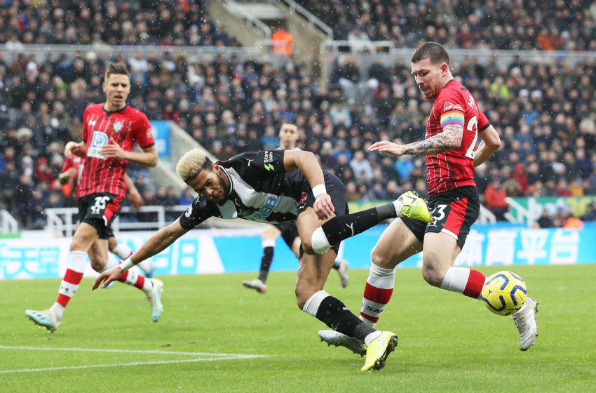NEWCASTLE UPON TYNE, ENGLAND - DECEMBER 08: Joelinton of Newcastle United battles for possession with Pierre-Emile Hojbjerg of Southampton during the Premier League match between Newcastle United and Southampton FC at St. James Park on December 08, 2019 in Newcastle upon Tyne, United Kingdom. (Photo by Jan Kruger/Getty Images)