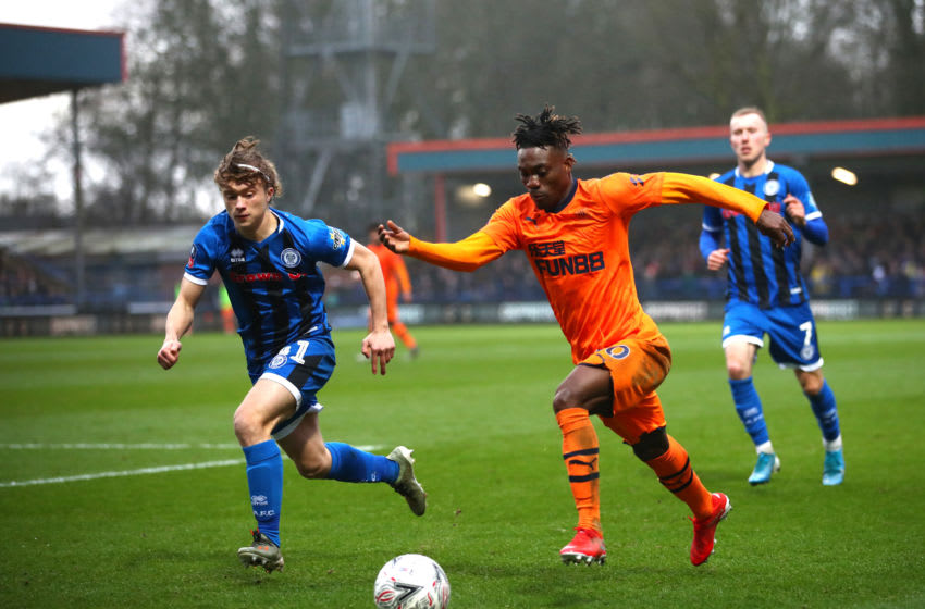 ROCHDALE, ENGLAND - JANUARY 04: Christian Atsu of Newcastle United runs past Luke Matheson of Rochdale during the FA Cup Third Round match between Rochdale AFC and Newcastle United at Spotland Stadium on January 04, 2020 in Rochdale, England. (Photo by Clive Brunskill/Getty Images)