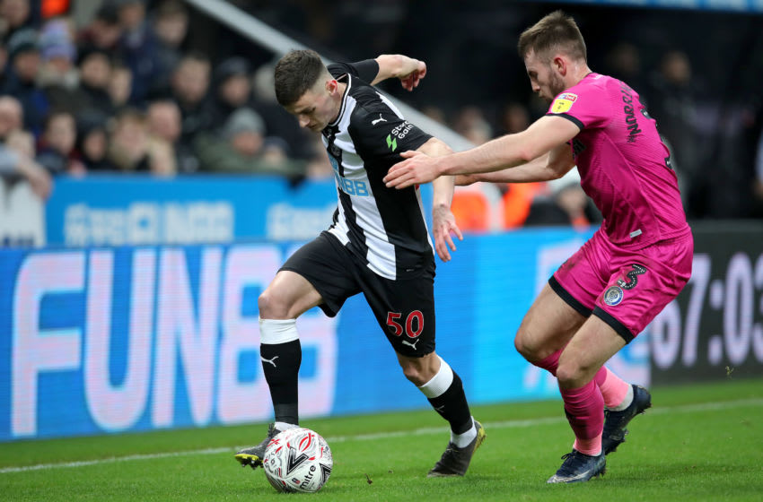 NEWCASTLE UPON TYNE, ENGLAND - JANUARY 14: Thomas Allan of Newcastle United is challenged by Rhys Norrington-Davies of Rochdale during the FA Cup Third Round Replay match between Newcastle United and Rochdale at St. James Park on January 14, 2020 in Newcastle upon Tyne, England. (Photo by Ian MacNicol/Getty Images)