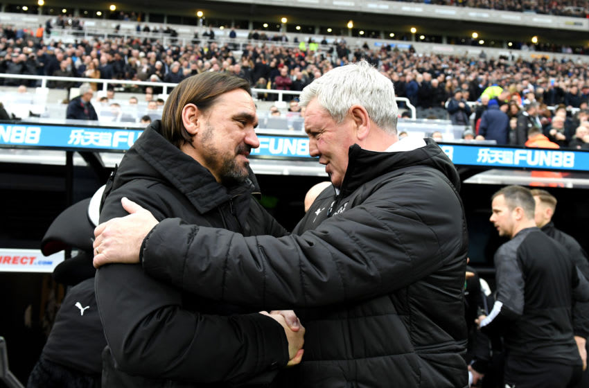 Daniel Farke, Manager of Norwich City speaks to Steve Bruce, Manager of Newcastle United.(Photo by Mark Runnacles/Getty Images)