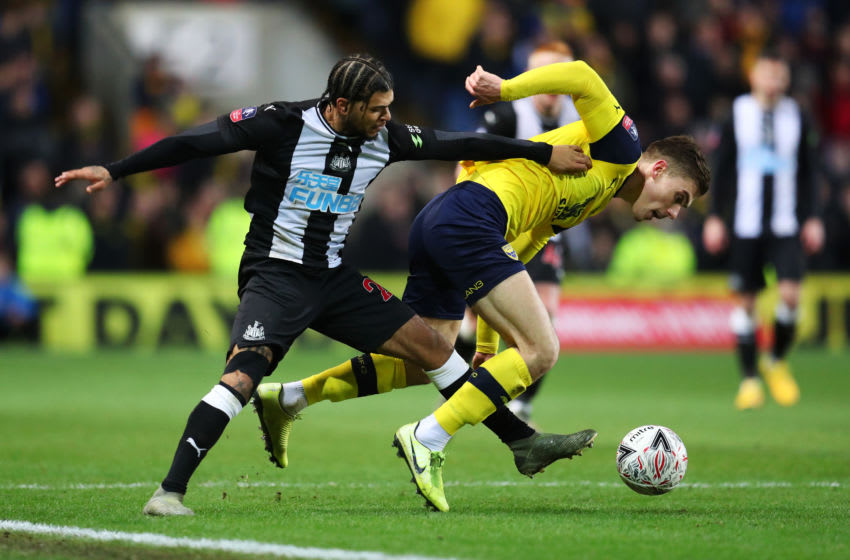 OXFORD, ENGLAND - FEBRUARY 04: Josh Ruffels of Oxford United is challenged by Deandre Yedlin of Newcastle United during the FA Cup Fourth Round Replay match between Oxford United and Newcastle United at Kassam Stadium on February 04, 2020 in Oxford, England. (Photo by Catherine Ivill/Getty Images)