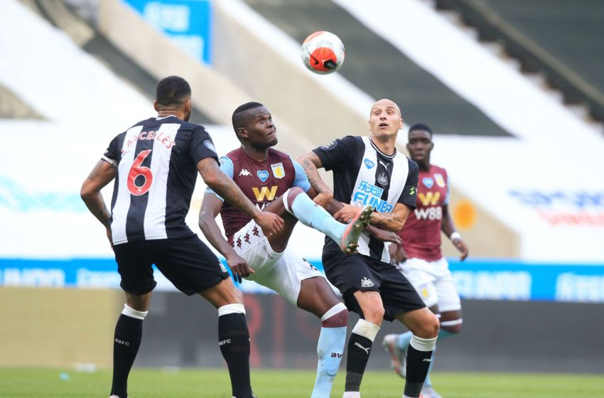 Aston Villa's Mbwana Samatta (2nd L) vies for the ball against Newcastle United's English midfielder Jonjo Shelvey (R). (Photo by Lindsey Parnaby / POOL / AFP) / RESTRICTED TO EDITORIAL USE. No use with unauthorized audio, video, data, fixture lists, club/league logos or 'live' services. Online in-match use limited to 120 images. An additional 40 images may be used in extra time. No video emulation. Social media in-match use limited to 120 images. An additional 40 images may be used in extra time. No use in betting publications, games or single club/league/player publications. / (Photo by LINDSEY PARNABY/POOL/AFP via Getty Images)